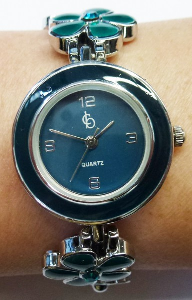 wunderschöne Damenuhr Quarzwerk mit feinem Blumenmuster in Dunkel und hellem grün, das Edelstahlgehäuse ist dunkelgrün lackiert, mit funkelnden grünen Kristalle, das Band ist aus Metall, Sie haben bei dieser Uhr die Möglichkeit die Größe zwis